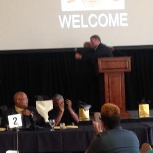 Jacob Sipe presenting Ed Tipton with award